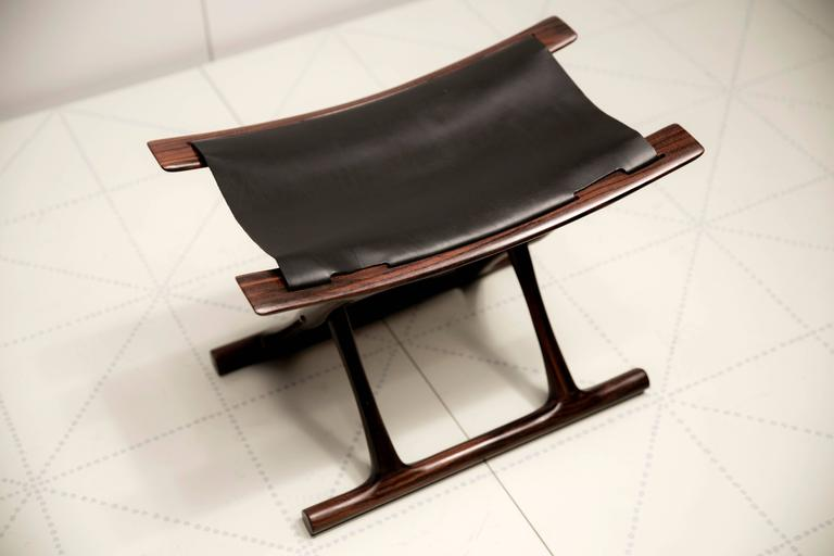 Cabinetmaker P.J. Furniture, Copenhagen (cabinetmaker's plaque on the underside of the stool).  Designed 1957; this stool made in 2000.  Indian rosewood, black leather (additional matching examples are available in both rosewood and