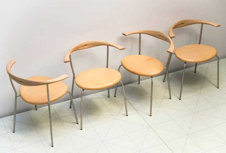 Set of Four Stackable Bull Horn Chairs, Model PP701 by Hans Wegner. Hans designed this chair to be used in the dining room of his own home in Gentofte, north of Copenhagen. It is a compact and stackable version of his famous 1960 bull horn chair and
