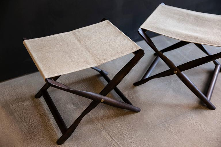 Pair of Propeller Stools in Fumed Ash with Linen Seats by Kaare Klint. Kaare designed this stool in 1930. His intention was for the legs to be cut-out of a single round piece of wood. A prototype was made in 1956, but due to the complexity of the