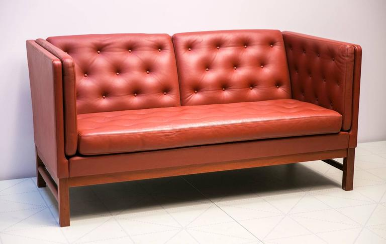 Offerd by Vance Trimble, Freestanding Two-Seat Sofas with Button Fitted Cushions by Erik Ole Jørgensen. Erik Jørgensen trained as a leather upholstery specialist, and early in his career he worked with Danish design legend Kaare Klint. This classic