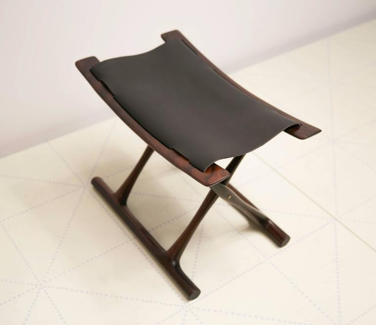 Egyptian Folding Stool by Ole Wanscher in Indian Rosewood and Black Leather. Wanscher's Egyptian stool is one of the icons of Danish design. As was typical of Wanscher, he looked back to previous furniture forms for inspiration and