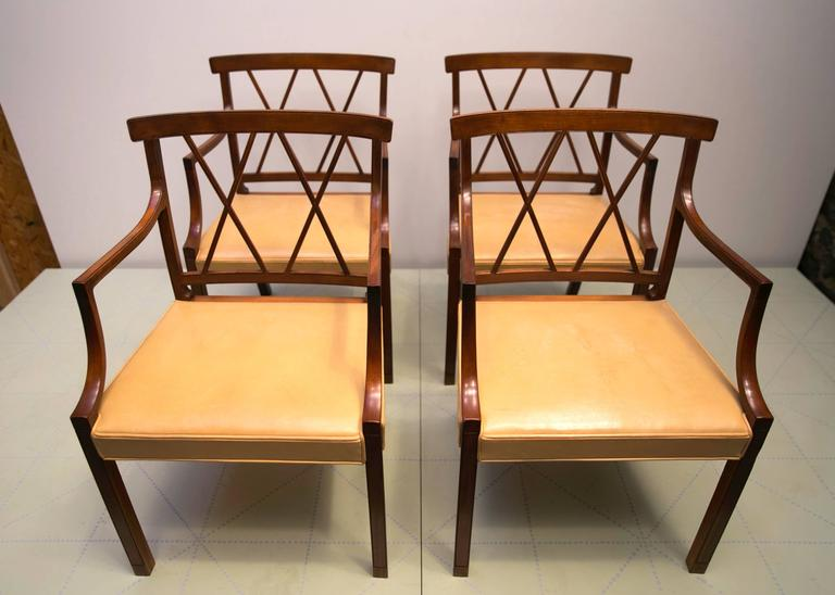 Four Elegant Armchairs by Ole Wanscher, Cuban Mahogany and Original Pale Leather. These elegant and beautifully detailed armchairs were designed by Wanscher in 1943. As is typical of Wanscher and his master cabinetmaker A.J. Iversen, the delicate