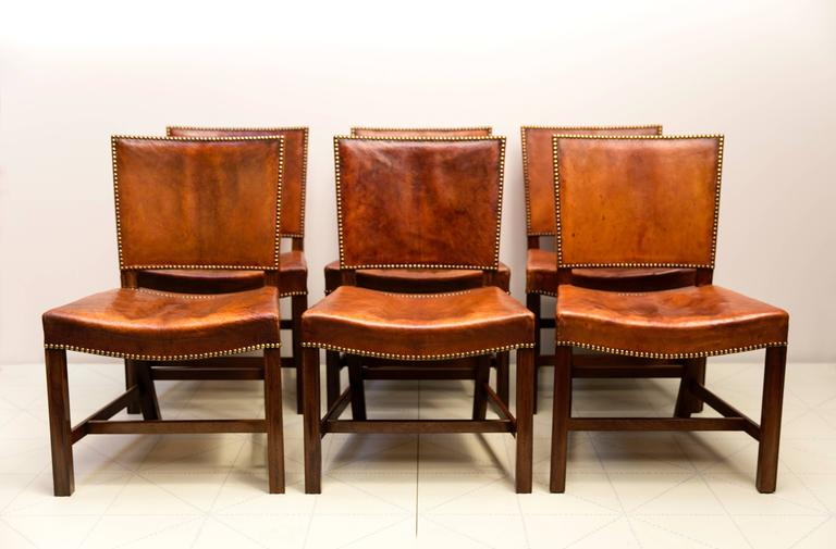 "Offered by Vance Trimble, six Large ""Red Chairs"" by Kaare Klint in Original Patinated Nigerian Goatskin. This early set of six chairs in Cuban mahogany retains its original highly patinated Nigerian goatskin upholstery and brass nails.  About"