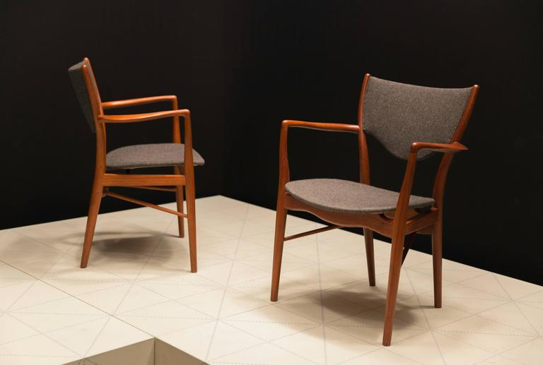 Pair of Finn Juhl BO-46 Chairs in Teak and Original Charcoal Wool Seats. Finn Juhl originally designed this chair for cabinetmaker Niels Vodder in 1946. In his second version, made by Bovirke from 1953, Finn Juhl's aim was to emphasize the lightness