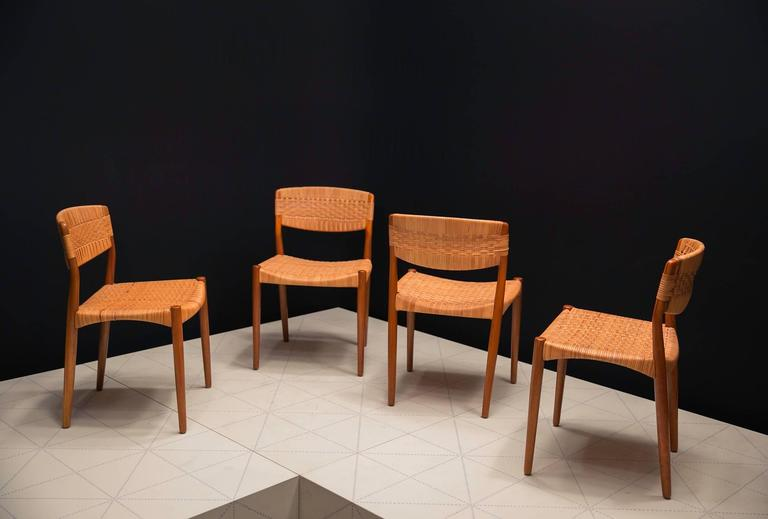 Set of Four Dining Chairs by Ejner Larsen and Axel Bender Madsen by Willy Beck. Ejner Larsen and Axel Bender Madsen first exhibited this chair at the 1955 Copenhagen Cabinetmakers' Guild Exhibition on the stand of master cabinetmaker Willy Beck.
