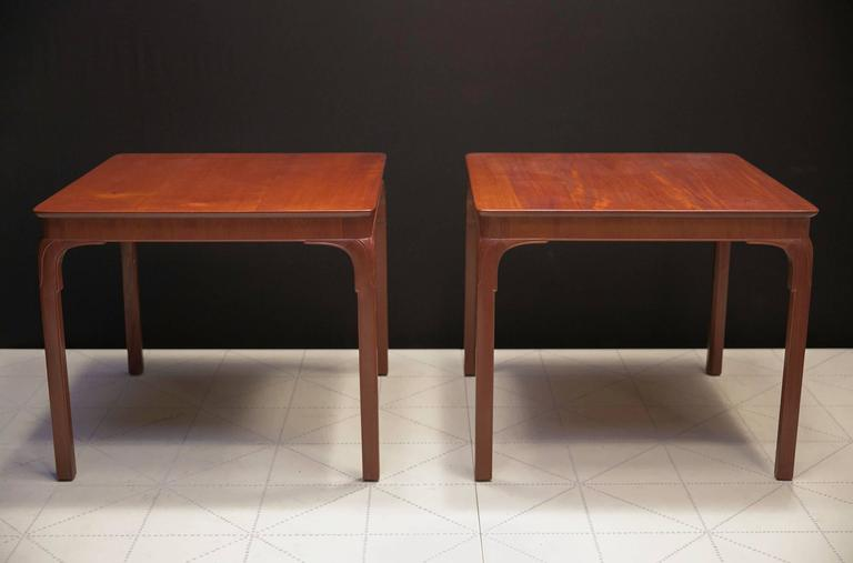 Frits Henningsen's Monumental Side Tables, Solid Cuban Mahogany and Carved Legs. Frits Henningsen designed this table in the 1930s as a games or cafe table with a chair clearance of 26 5/8 inches under the apron.   Today, these tables could also be