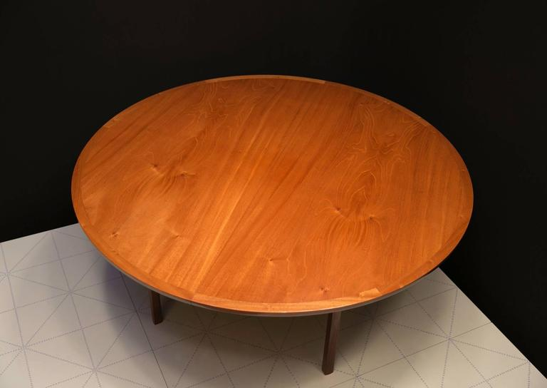 Offered by Vance Trimble, Ole Wanscher's Elegant Extendable Round Dining Table in Mahogany. This table has three leaves, one with apron. Each leaf measures 23 5/8 x 67 inches. The table can accommodate 6, 8, 10 or 12 people.  Chair clearance is 27