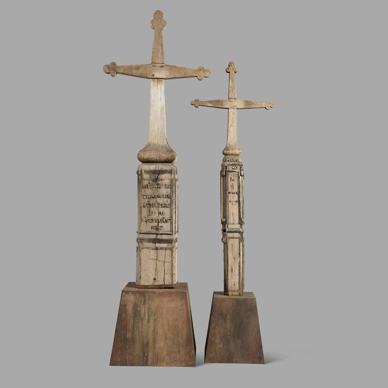 Both carved crosses are from the same family, probably two sisters. Despite the many flaws in their lettering, one can still read 'Marie 1889' and 'Helen, died on December 1887 10th'.