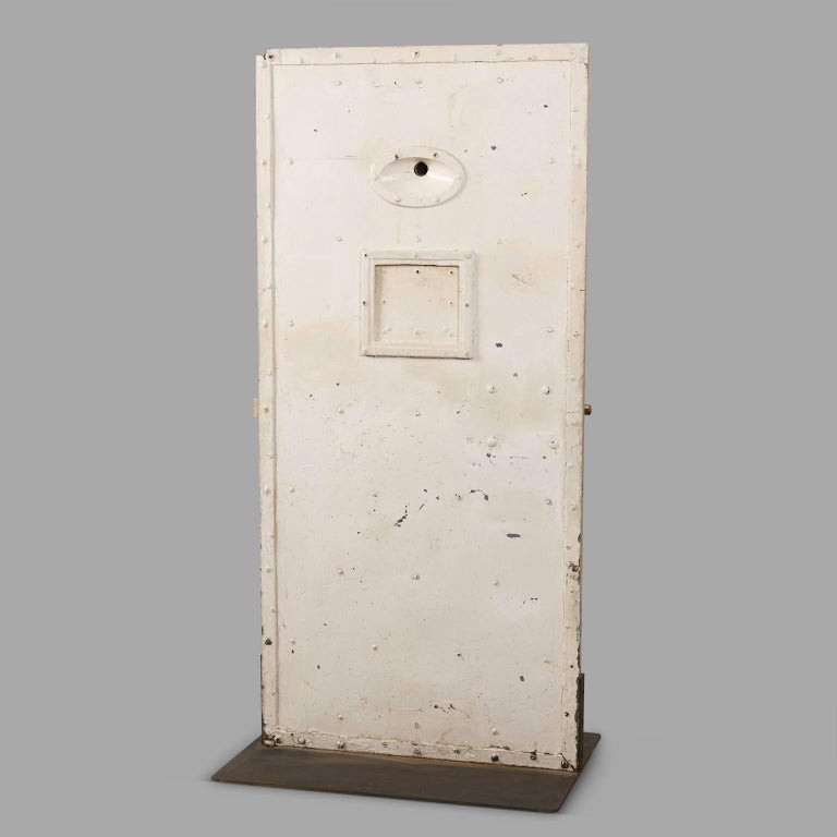 Jail cell door made of solid oak and riveted sheet metal. With genuine mechanisms and keys. Stabilized on sheet metal slab.