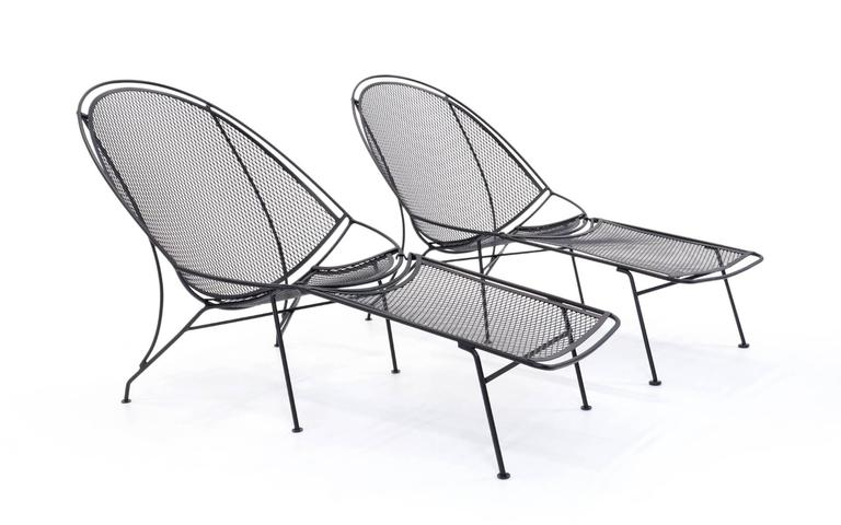 FOUR AVAILABLE.  This listing is for two (one pair) Rare and desirable version of the high back lounge chair, with removable footrest / ottoman, designed and made by the John Salterini Company, Brooklyn NY, 1965. These have been professionally media