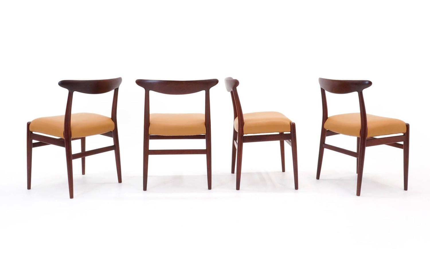 Set of eight teak and leather hans wegner dining chairs at for Wegner dining chair