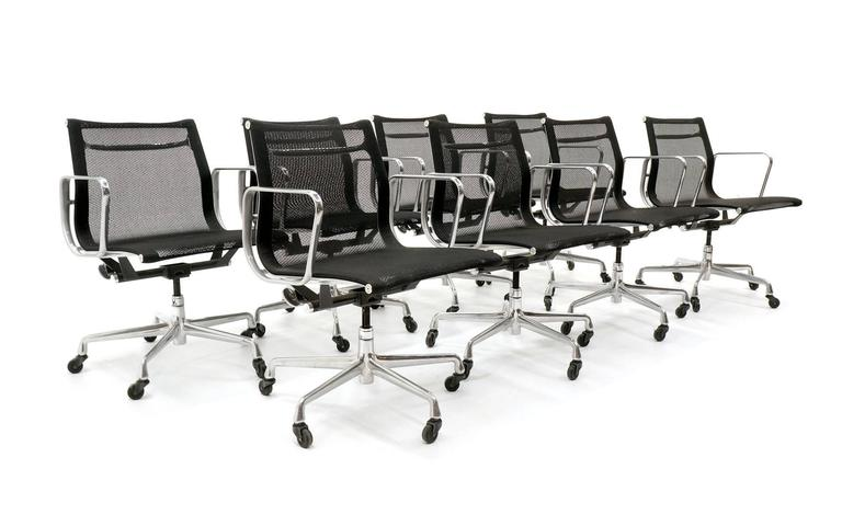 We have ONE PAIR remaining of these beautiful Charles and Ray Eames for Herman Miller aluminum group chairs upholstered in the original black mesh.  Chairs are on casters. Lightly used, excellent condition.
