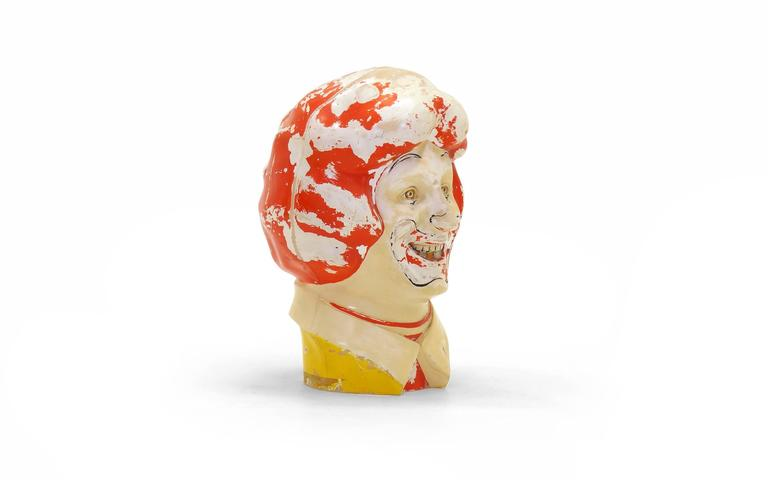 It's strange and freaky, but so cool. Vintage Ronald McDonald plastic clown head sculpture. By the way, it is hollow inside and can be put over ones head and you can see through the hole in the mouth. That hole was originally for a helium dispenser.