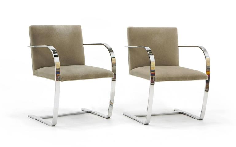 Brno chairs designed by Mies van der Rohe. Two chairs available. These are the original authorized Knoll production in triple chrome-plated to a mirror finish bar stock steel and original Knoll felt/velvet fabric. These make great dining chairs or