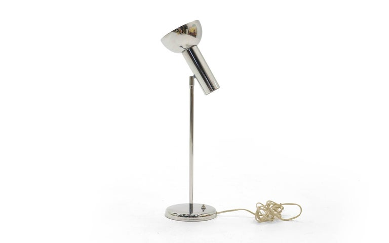 Adjustable table lamp designed by George Kovacs in polished chromed steel. Perfect as a reading lamp or accent lamp.