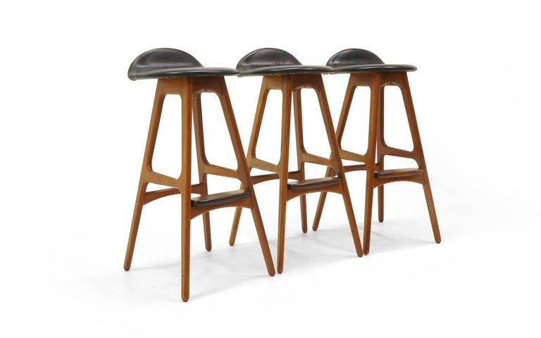Erik Buch teak barstools. Teak and rosewood with black leather seats.  30 inch seat height.