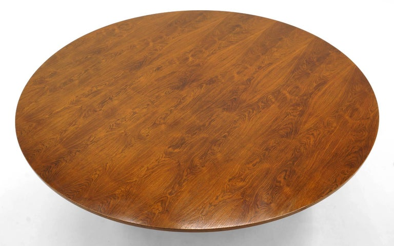 This unique prototype table was designed by George Nelson and features a 1.5 inch thick Brazilian rosewood top made from lumber Nelson selected on a trip to Brasilia and meeting with Oscar Niemeyer. It never went into production due to the high cost