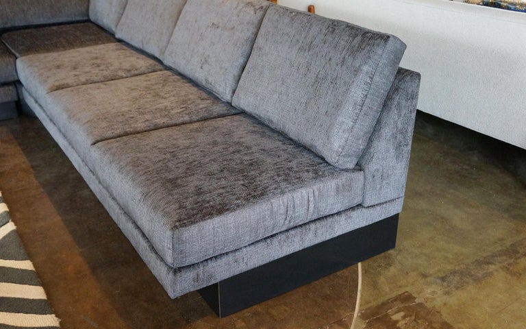 Large three-piece sectional sofa designed by Milo Baughman for Thayer Coggin. Consists of a pair of three-seat armless sofas and a corner piece making for any number of configurations beyond the obvious corner L shape configuration. Three-seat sofa