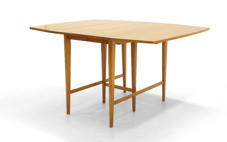 Drop-Leaf Dining Table by Paul McCobb, Expandable with Three Leaves, Solid Maple In Excellent Condition For Sale In Kansas City, MO