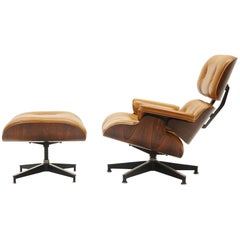 Rare Eames Lounge Chair and Ottoman in Rosewood and Original Cognac Leather