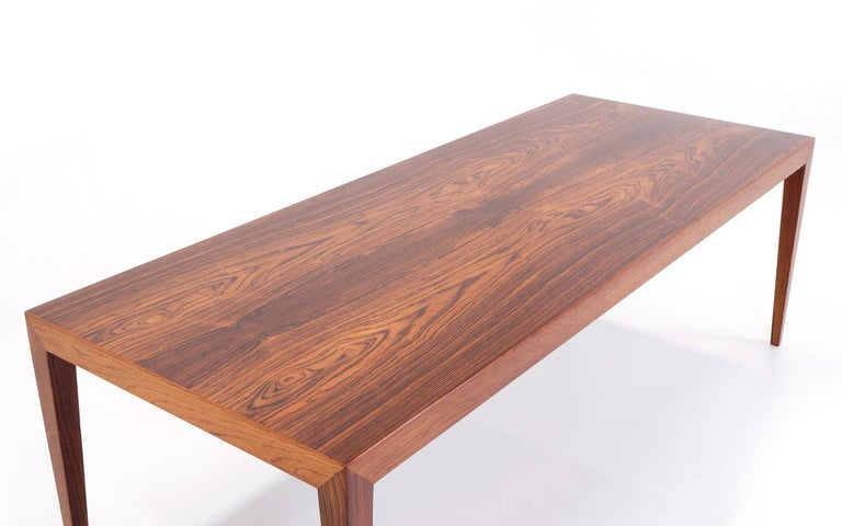 Stunning Brazilian rosewood coffee table signed Fritz Hansen, Denmark. In remarkably excellent original condition.