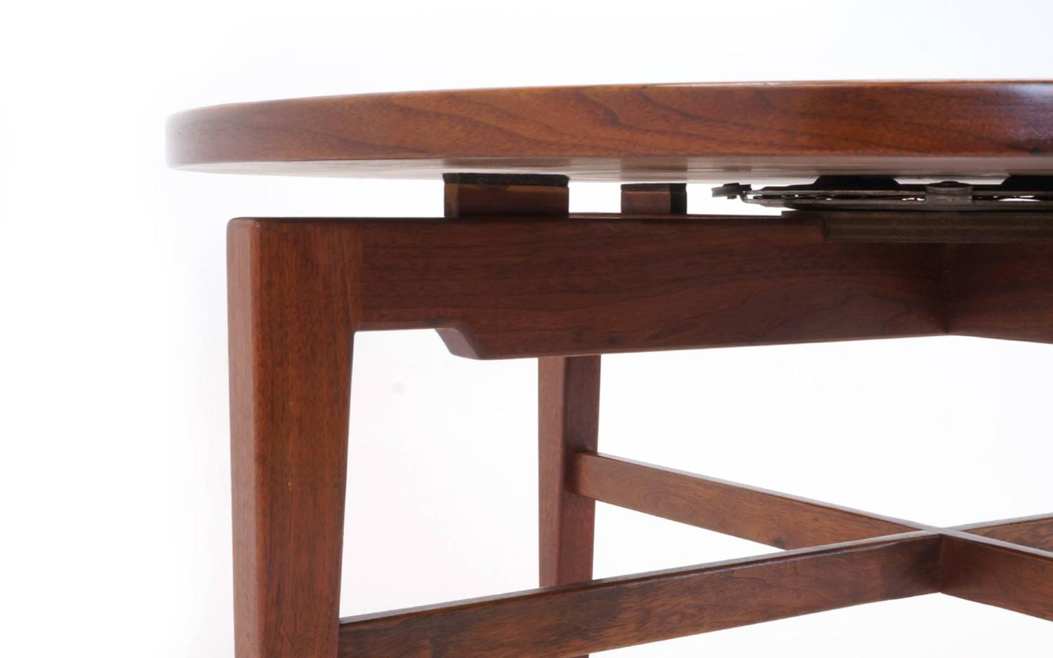 Revolving dining table top jens risom revolving top lazy for Rotating dining table