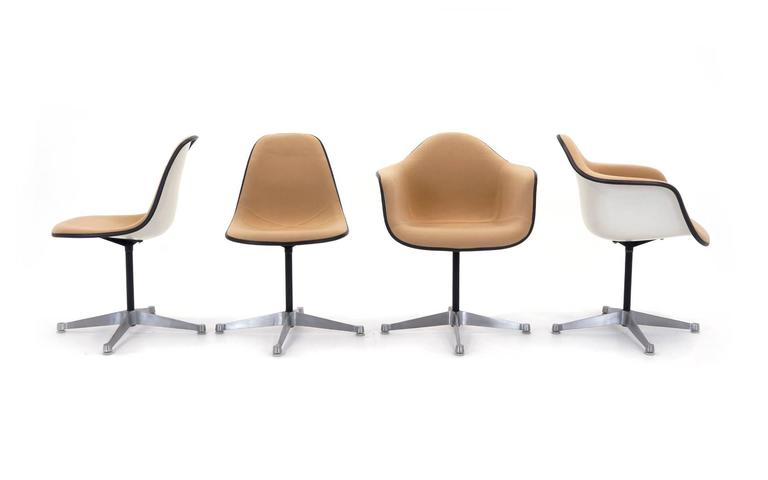 Set Of Eight Charles And Ray Eames Fibergl Swivel Chairs With Cream Colored Upholstery Two