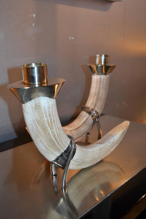 1970s Christian Dior faux resin tusk and silver plated candlesticks. Signed Christian Dior. Great vintage condition.