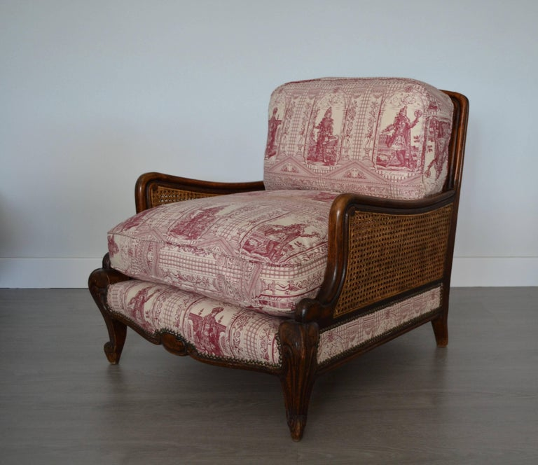 Wood and wicker armchair upholstered with toile de jouy, 1900. Good vintage condition.