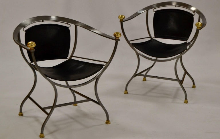 Two armchairs 1970s Italian designer Alberto Orlandi Pair of 1970s steel, bronze and black leather armchairs by the Italian designer Alberto Orlandi Pompei model. (May sell one piece).