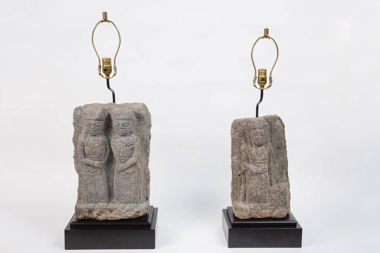 Pair of stone fragment lamps. Central American stone fragments are over 300 years old and have been mounted onto wood bases.  Lamps have been fully wired.  Fragments differ in size and height but can be successfully used together or separately.