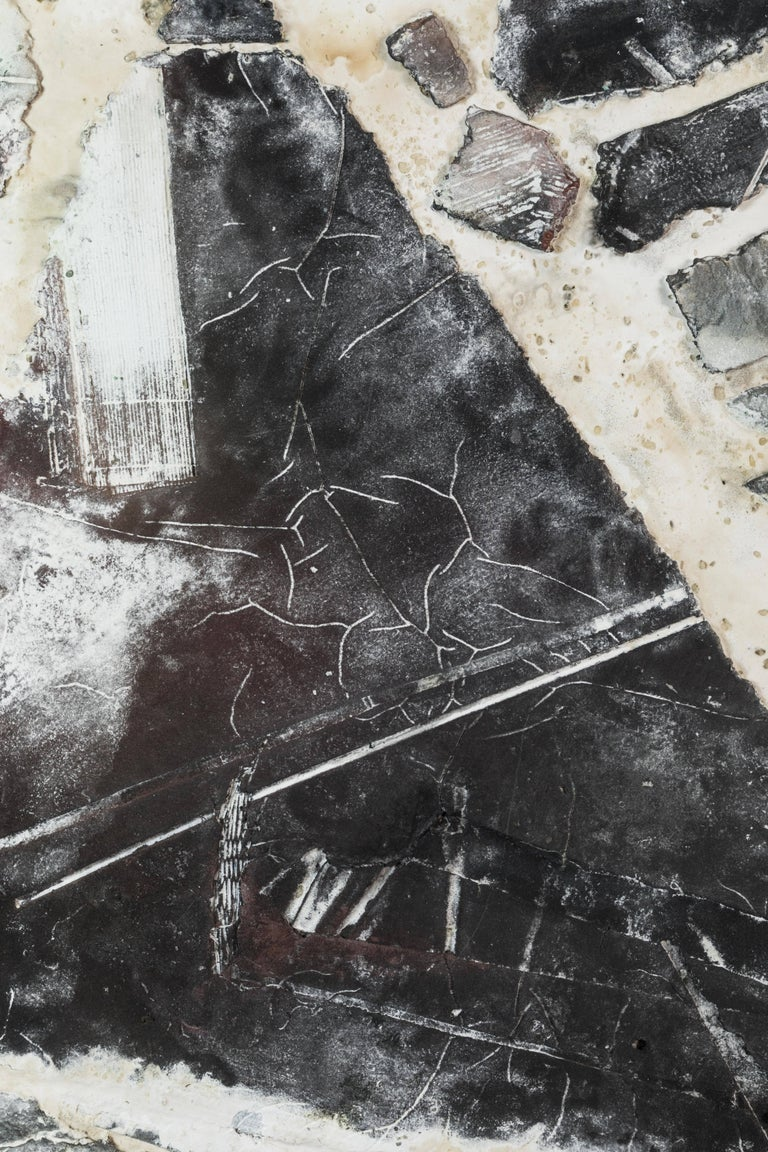 Modern, primitive abstract are all words that describe this stunning mixed media work from the 1990s. Done in a black and white palate the piece feels rather archaeological, as if it had been unearthed from some ancient place. Highly decorative.