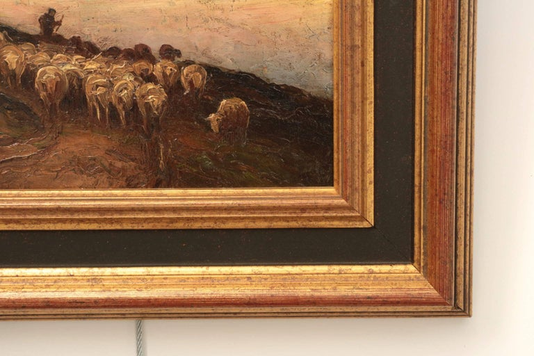 A fine Barbizon work by the American artist Francis Wheaton, this oil on panel depicts an evening scene of a shepherd bringing his flock home after a day at pasture. The complex sky is warm and chaotic with hints of pink over the horizon blending