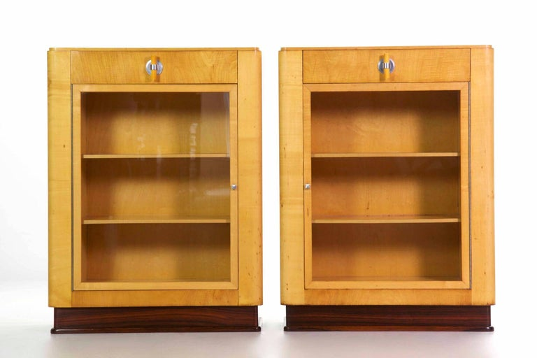 This pair of bookcases with their single drawer are designed with the very essence of the Art Deco movement expressed fully in their form. Angular and free of any excessive surface embellishment, they explore the newest and most innovative materials
