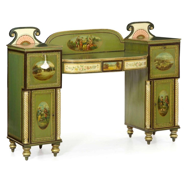 A striking pedestal sideboard with an overall green ground polychrome surface against gilded highlights, the sideboard is knock-down for easy and safe transport. The arched backdrop is enhanced with a large classical genre scene of figures