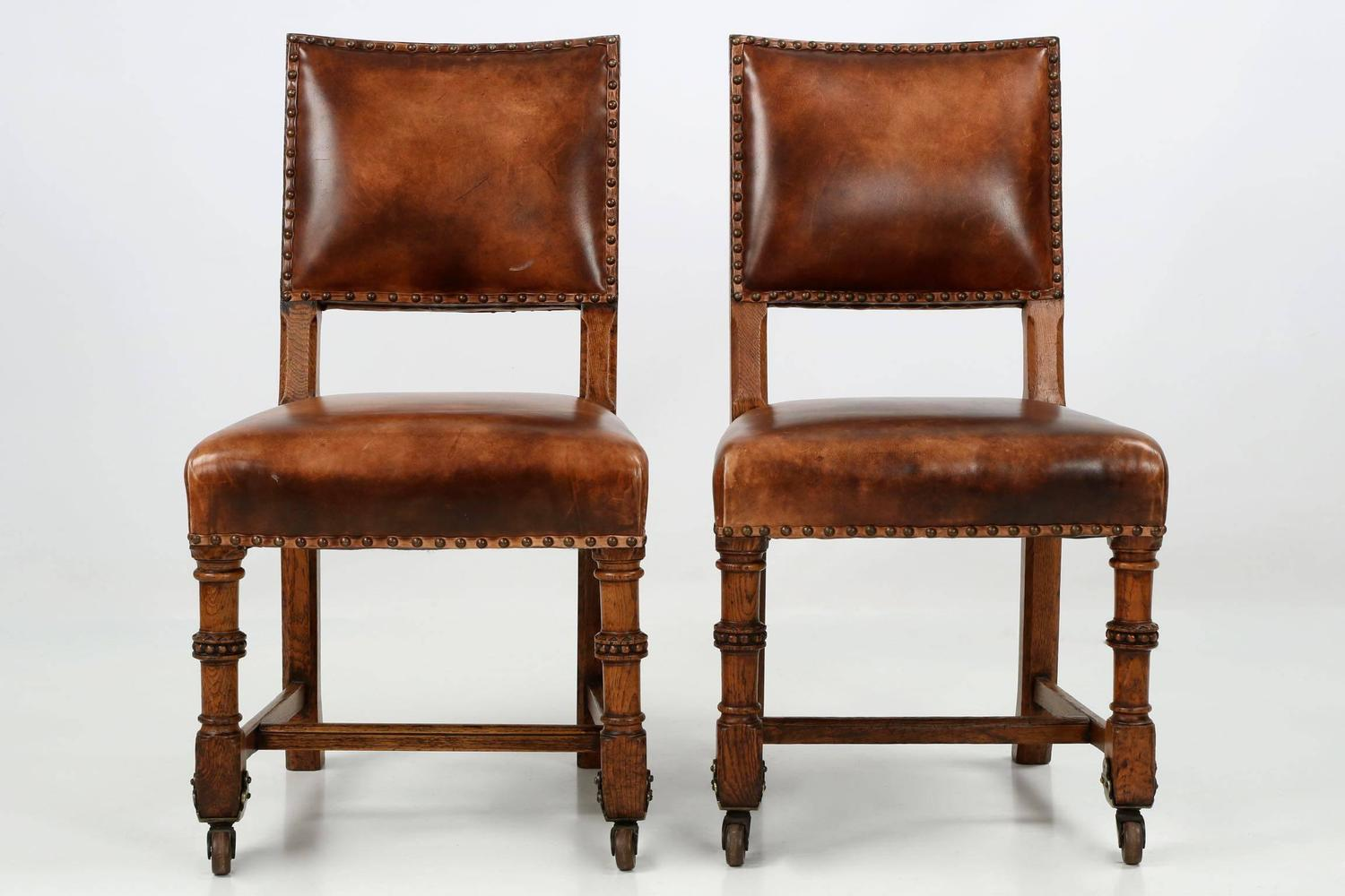 Of four chairs in oak and patinated cognac leather for sale at 1stdibs - Pair Of English Antique Leather And Carved Oak Side Chairs
