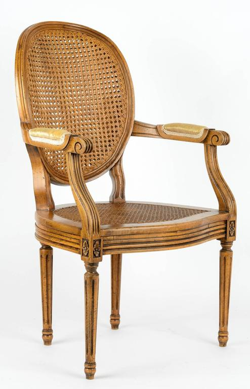 Hand-Carved Louis XVI Armchair with Cane Back and Seat For Sale