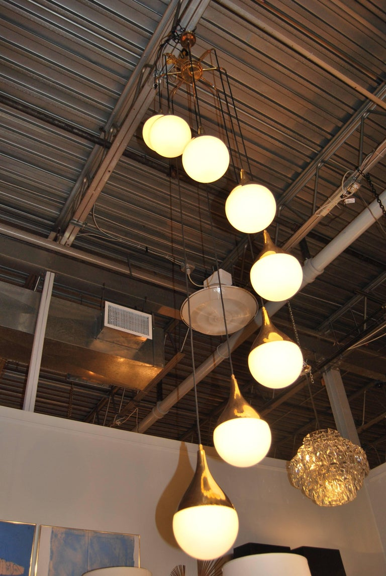 Mid-Century Modern Large Pair of Stilnovo Style Cascading Chandeliers with Brass and Glass Shades For Sale