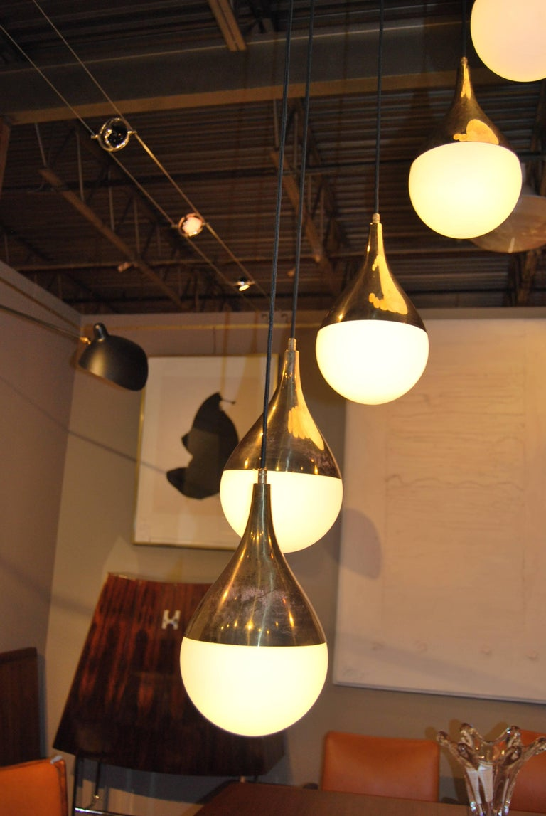 Italian Large Pair of Stilnovo Style Cascading Chandeliers with Brass and Glass Shades For Sale