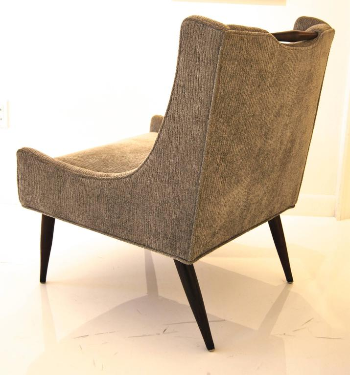 Elegant pair of slipper chairs by Harvey Probber, upholstered in charcoal grey chenille with exposed walnut handle.