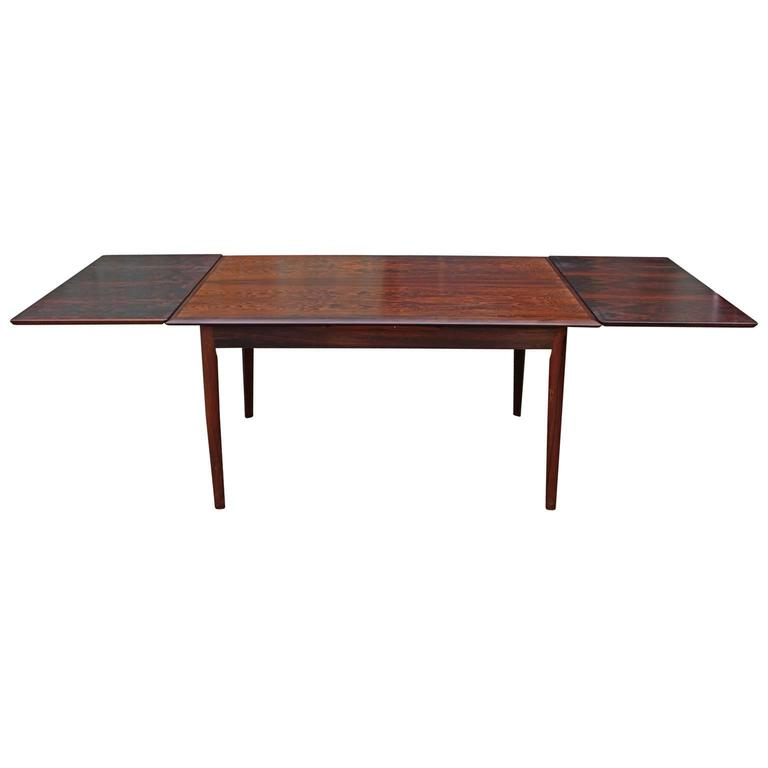 elegant and clean lined danish rosewood dining table two leaves pull