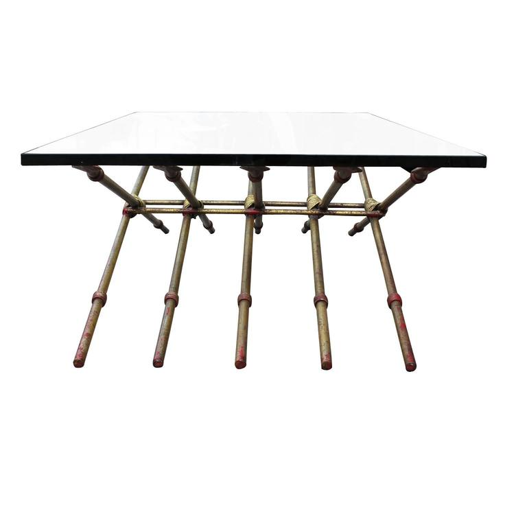 Ten Gold Leafed Spears Intertwined To Make To A Wonderful Glass Coffee  Table. The Table