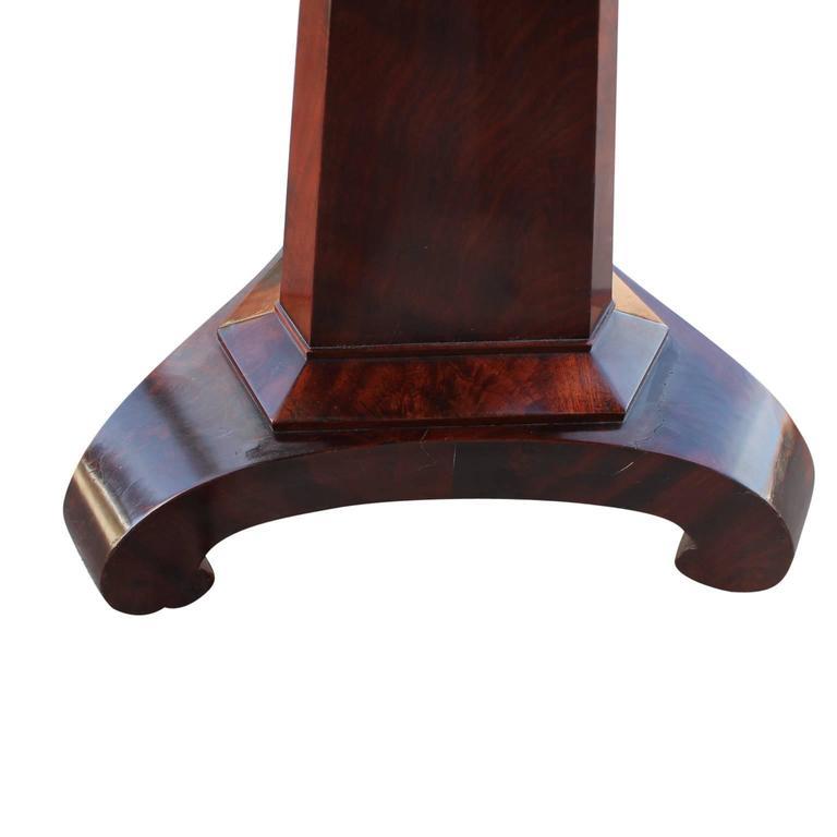 Early Empire mahogany adjustable piano stool.