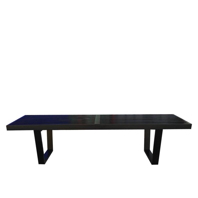 Iconic George Nelson platform, slat bench for Herman Miller with an aged black lacquered finish.