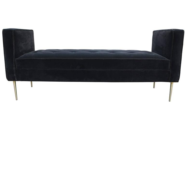 Gorgeous modern armed bench in a dark grey velvet featuring brass legs. The piece was designed by Reeves Art & Design in Houston, Texas.