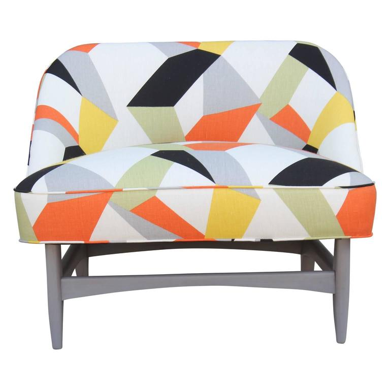 Pair Adrian Pearsall style sculptural lounge / slipper chairs recently upholstered in a bold geometric print that includes orange, black, white, gray and mint green. A single ottoman is also included, making it a perfect lounge set!