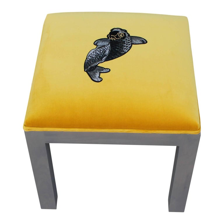 Luxe modern pair of custom-made deep yellow Kravet velvet ottomans with detailed applied Koi embroidery. A grey stain overlay on simplistic legs. Style from either Parsons School of Art and Design or Milo Baughman. We can custom make these for you