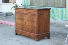19th Century French George X Style Walnut Chest of Drawers w/ a Marble Top