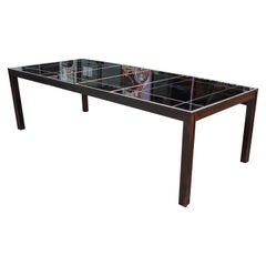 Modern Rectangular Black Dining Table with a Smoked Mirror Top and Brass Inlay