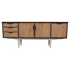 Mid-Century Modern Two-Tone Credenza with Natural Finish Legs and Three Drawers